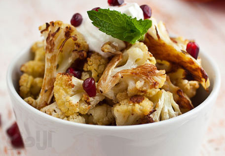 cumin-seed-roasted-cauliflower-with-salted-yogurt-mint-and-pomegranate-seeds